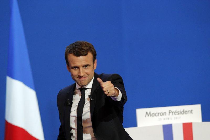 法國總統大選23日進行第一輪投票,中間派候選人馬克宏(Emmanuel Macron)以最高票進入第二輪(AP)