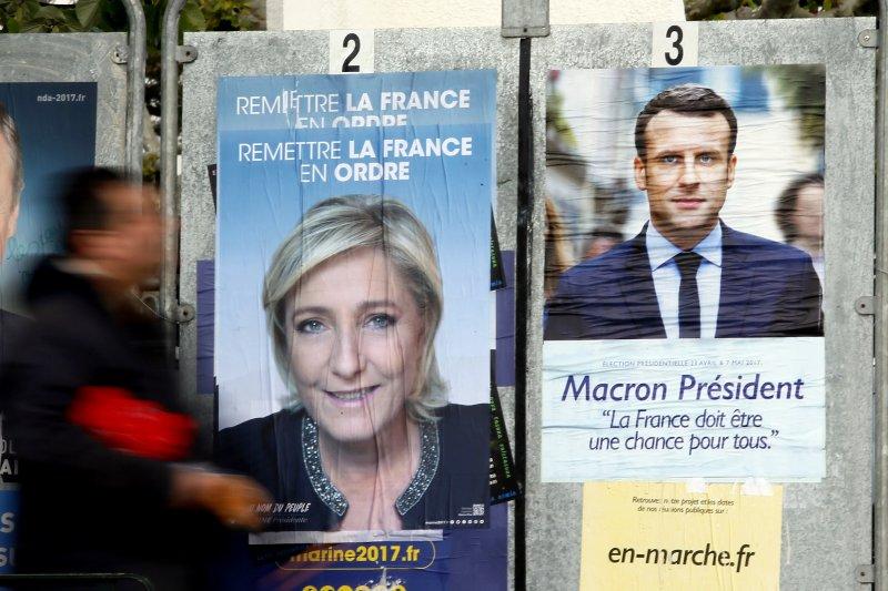 法國極右派總統候選人勒潘(左)將與中間派候選人馬克宏在5月7日爭奪總統大位(AP)