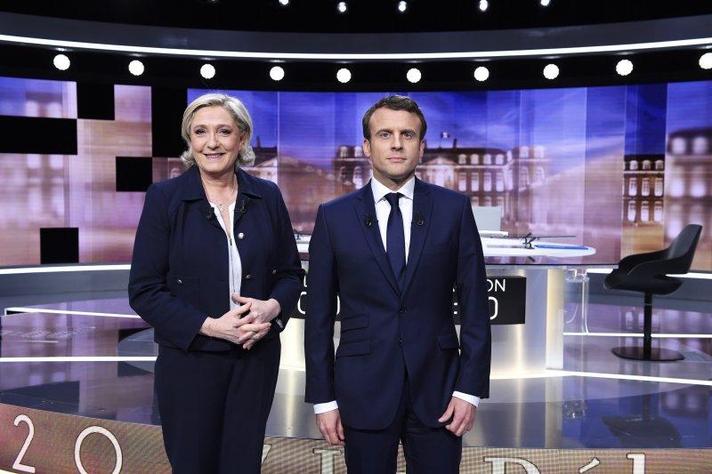 法國總統候選人馬克宏與瑪琳.勒潘3日晚間舉行電視直播辯論,兩人在諸多重大政策上都是南轅北轍(美聯社)