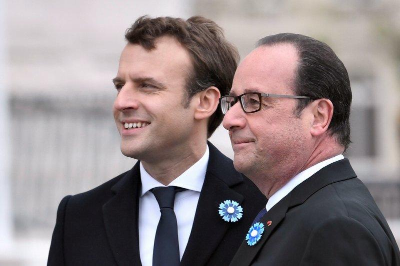 法國新任總統當選人馬克宏與現任總統奧朗德(AP)