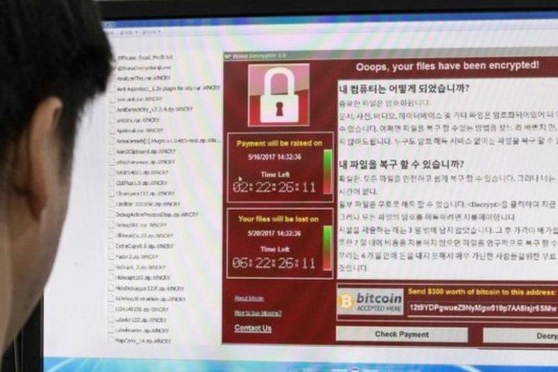 研究人員在分析「想哭」病毒軟件的勒索信息中發現只有中文和英文版似乎是手寫的。(BBC中文網)