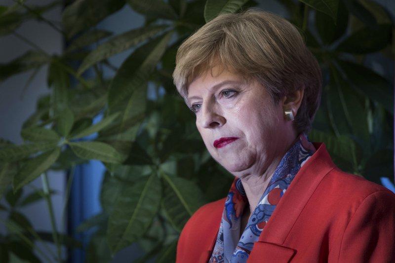 英國首相梅伊在這次大選慘輸(AP)