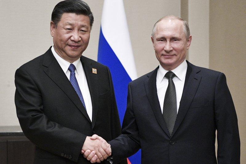 俄國總統普京與中國國家主席習近平。(美聯社)