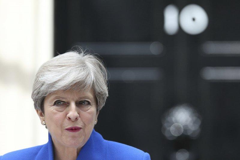 英國首相梅伊試圖透過大選鞏固執政,卻引發政治危機。(美聯社)