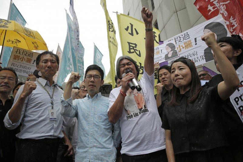 香港高等法院14日宣判,撤消(左起)姚松炎、羅冠聰、梁國雄、劉小麗4名特區立法會議員資格(AP)