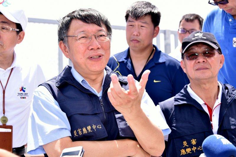 台北市長柯文哲31日受訪時再度對颱風預測失準,大家放了一個風和日麗的颱風假表達看法。(資料照片,台北市政府提供)