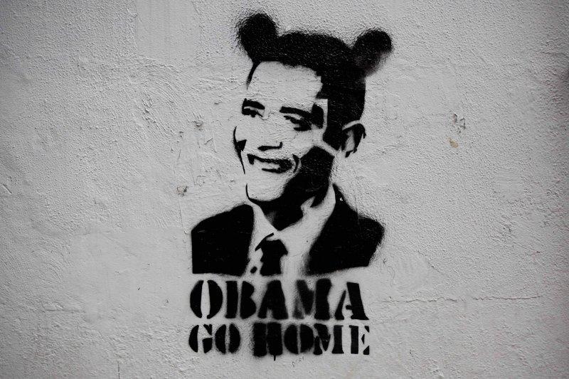 委內瑞拉街頭的歐巴馬肖像畫上多了2隻耳朵(AP)