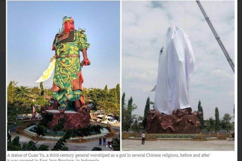 印尼東爪哇的關公像遭到當地穆斯鄰抗議,廟方只得先用白布蓋住。(取自twitter)
