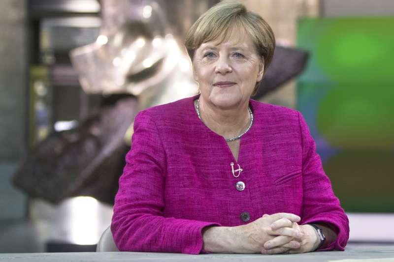 梅克爾為難民政策付出不小的政治代價,但她表示並不後悔。(AP)