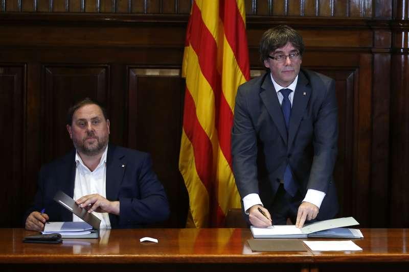 加泰隆尼亞獨立公投:加泰隆尼亞自治政府主席普吉德蒙簽署法案生效(AP)