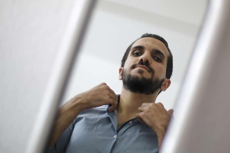25歲敘利亞難民納烏拉斯,在難民營住了2年後得到德國庇護,並找到翻譯工作。(美聯社)