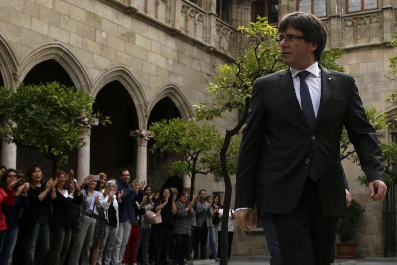 加泰隆尼亞自治區主席普吉德蒙表示,最快將在本週末和下周開始著手獨立工作。(美聯社)