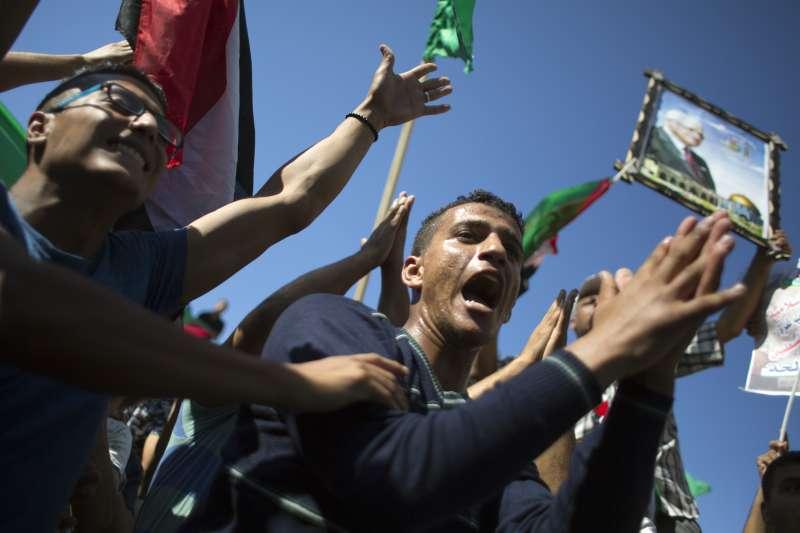 巴勒斯坦兩大山頭「法塔」與「哈瑪斯」日前終於達成和解,民眾歡欣鼓舞(AP)