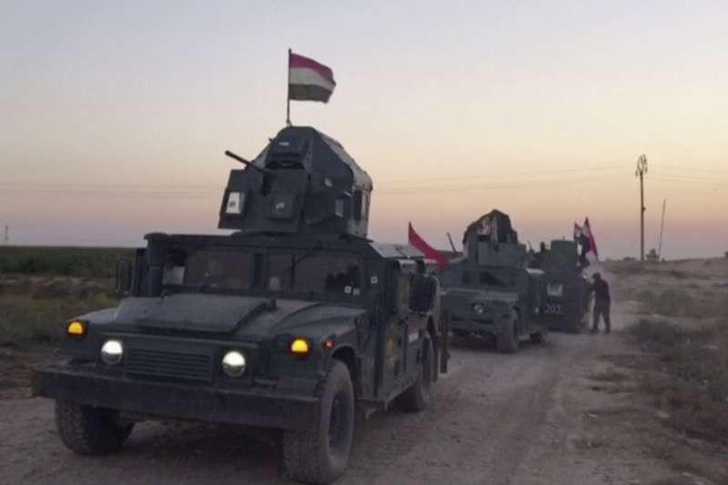 伊拉克政府軍16日進佔基爾庫克。(美聯社)