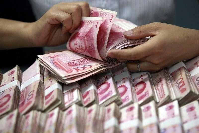 中國國家主席習近平肯定民企發展後,中國央行昨(22)日深夜公告,將增加央行貸款和重貼現額度人民幣1500億元、力挺支持民營企業。(圖取自美聯社)
