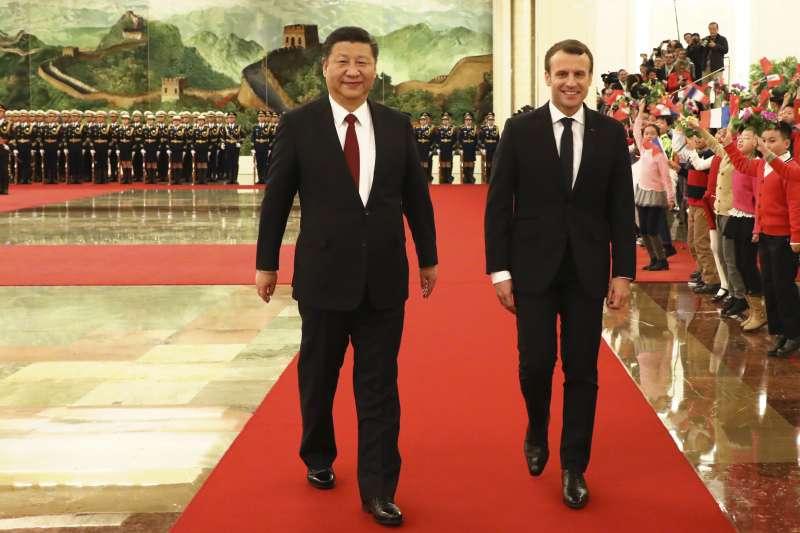 法國總統馬克宏訪中,會見中國國家主席習近平。(美聯社)