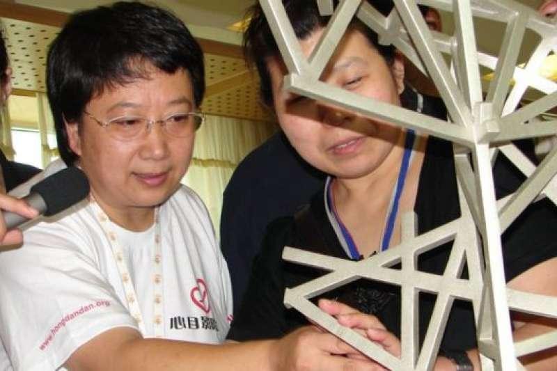 鄭曉潔在北京人為盲人開了一家電影院。(BBC中文網)