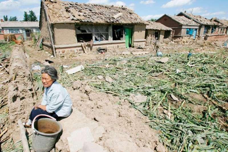 中共的經濟是建立在破壞與掠奪農村、農民的基礎之上。(Getty Images)