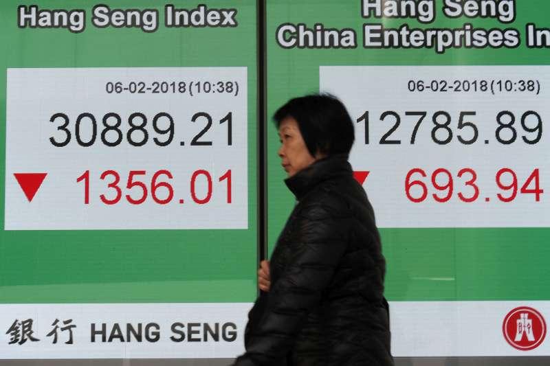 香港股市低迷,許多企業改私有化與重組。(資料照,AP)