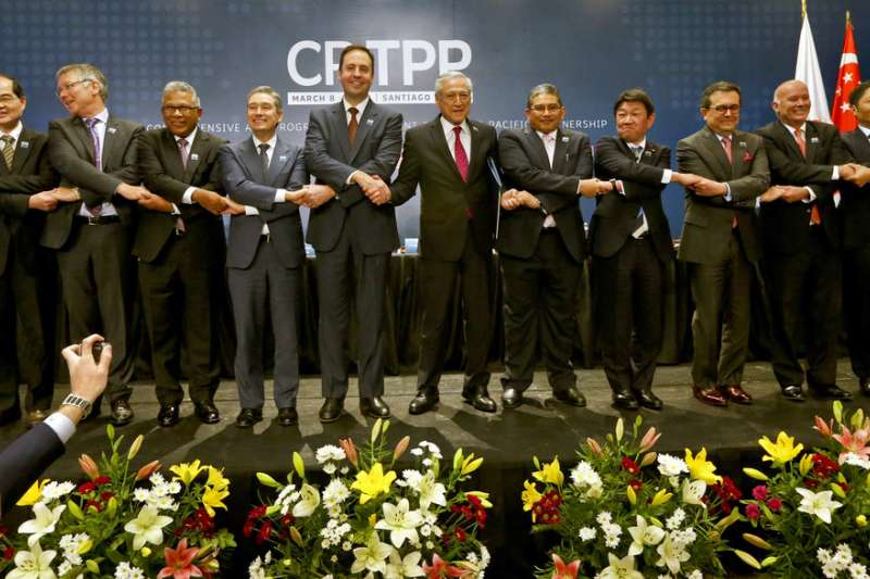 跨太平洋夥伴全面進展協定(CPTPP)11個會員日前在智利聖地牙哥簽署協定。(美聯社)