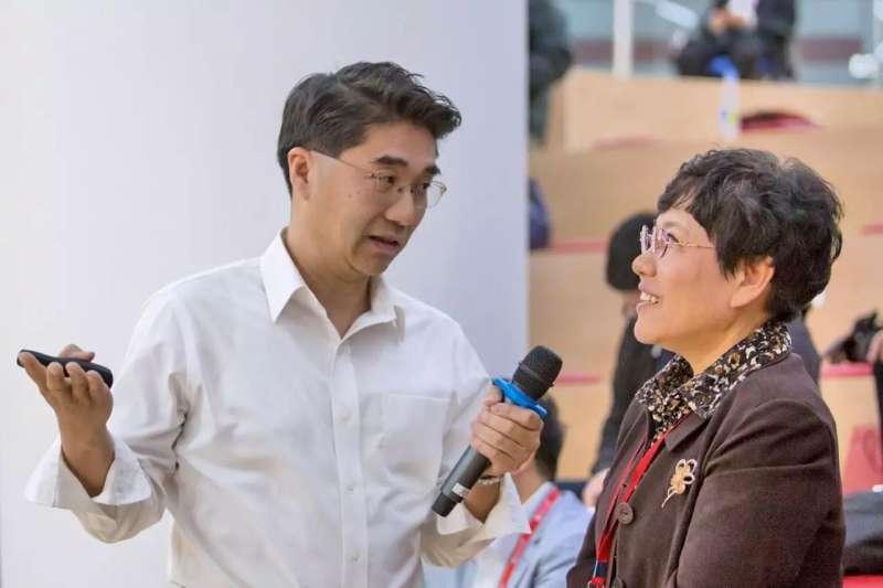 李沉簡(左)(北大)