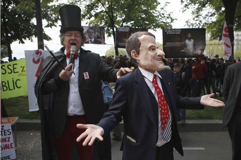 法國巴黎五一勞動節遊行:參與者反對法國總統馬克宏的勞動法規改革(AP)