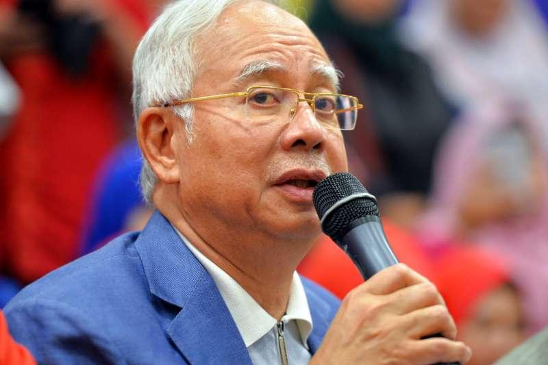 馬來西亞前總理納吉的住處5月16日晚間遭馬國警方搜索,圖為12日納吉宣布辭去巫統黨主席。(資料照,美聯社)
