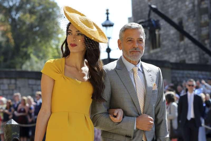 美國影星喬治克隆尼和妻子阿茉阿拉瑪汀受邀參加王室婚禮。(美聯社)