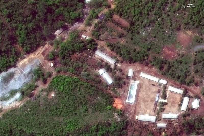 北韓24日在外媒見證下,炸毀豐溪里核子試驗場,圖為本月23日豐溪里核試場的衛星照片。(AP)