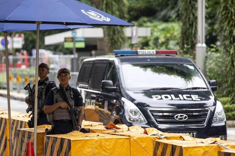 破天荒的世紀「川金會」12日在新加坡登場,新加坡增派警力、嚴陣以待。(美聯社)