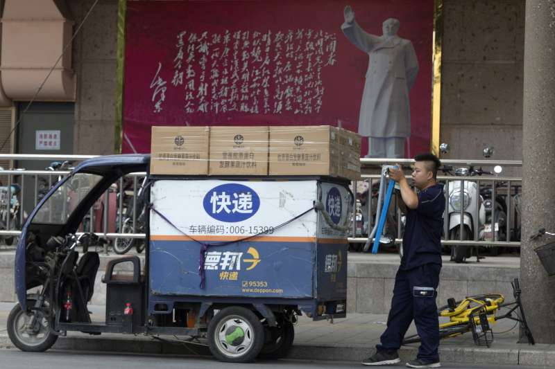 在中國逐步大規模實施的社會信用體系,被批評為歐威爾式的監控工具。(AP)