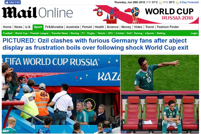 英國《每日郵報》捕捉到德國慘敗賽後,球迷與厄齊爾爆發肢體衝突。(截圖自《每日郵報》網站)