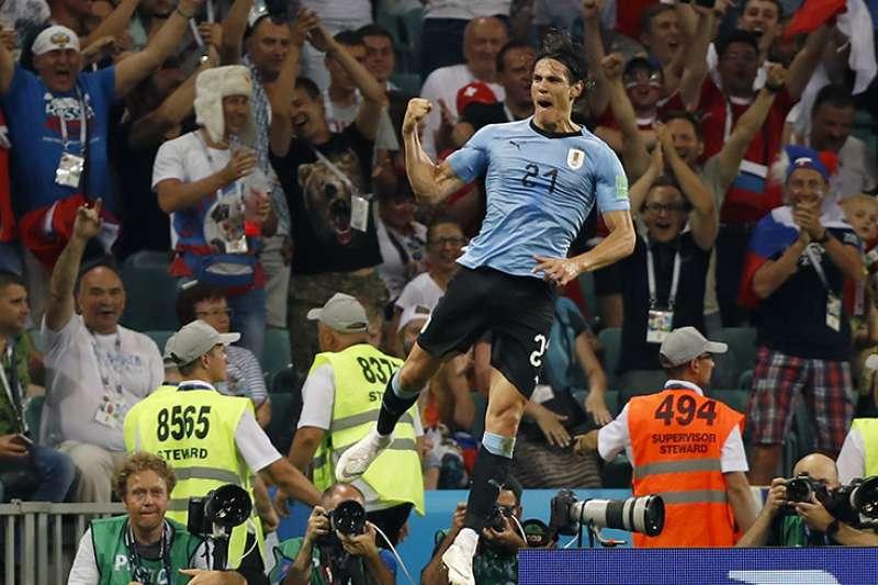 烏拉圭16強迎戰歐洲冠軍葡萄牙,在前鋒卡瓦尼個人梅開二度的表現下,終場以2比1擊敗葡萄牙,晉級世界盃8強。(美聯社)