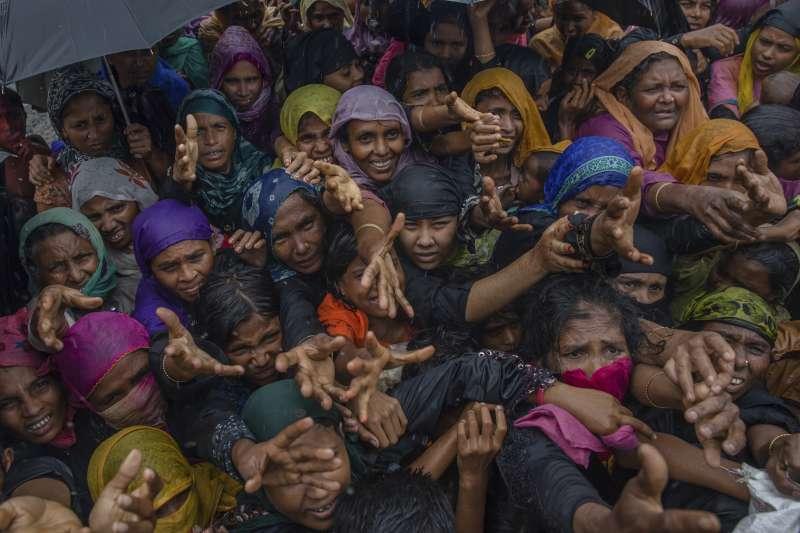 身處緬甸的羅興亞人由於宗教信仰的不同,淪為難民、甚至遭到種族屠殺,而類似的種族、宗教歧視也在印度阿薩姆邦持續進行中。(美聯社)