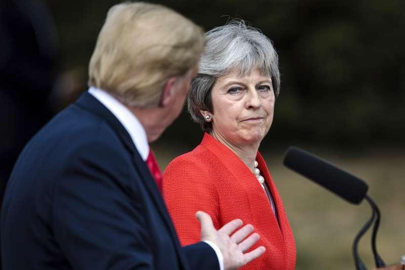 英國首相梅伊透露,川普建議她不需要跟歐盟進行脫歐協商,應該直接告他們。(美聯社)