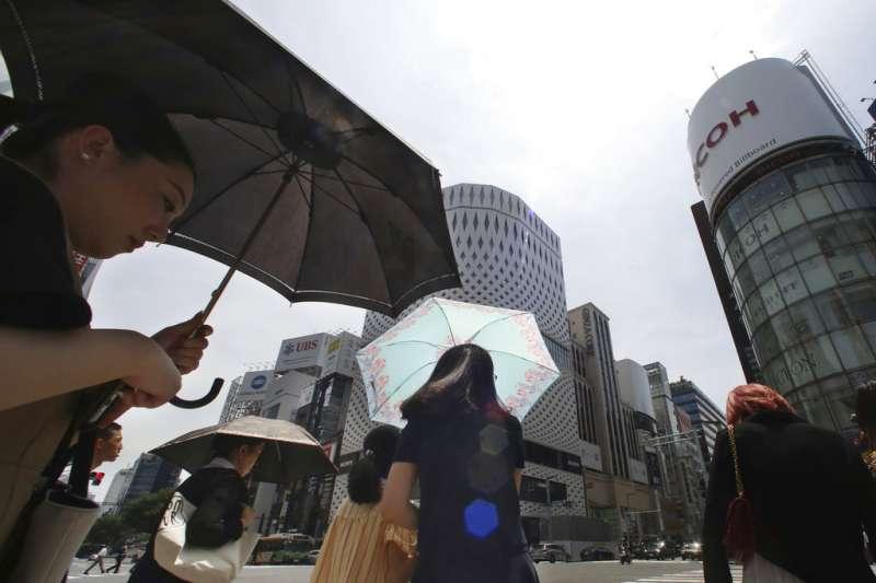 日本今夏酷熱,即便是東京也屢屢出現超過38度的高溫。(美聯社)