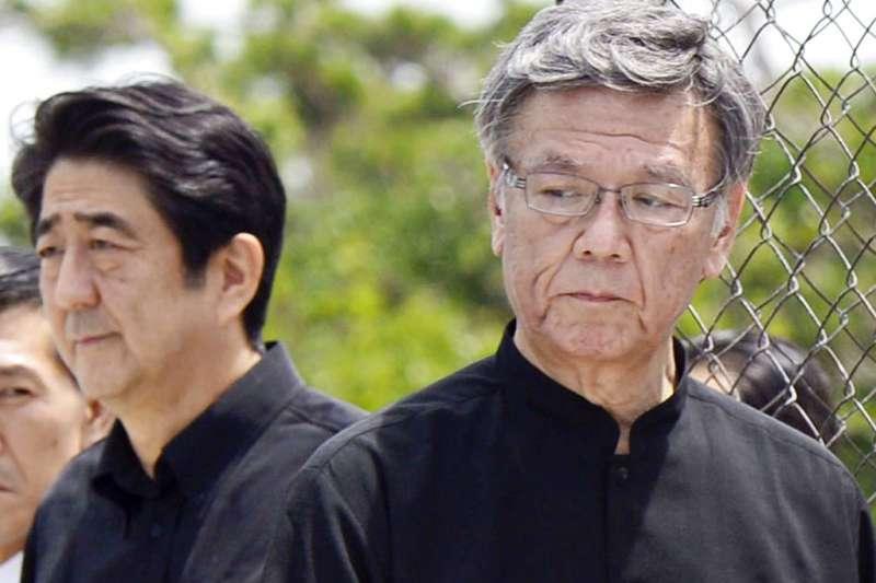 沖繩縣知事翁長雄志與他的政敵—日本內閣總理大臣安倍晉三。(美聯社)