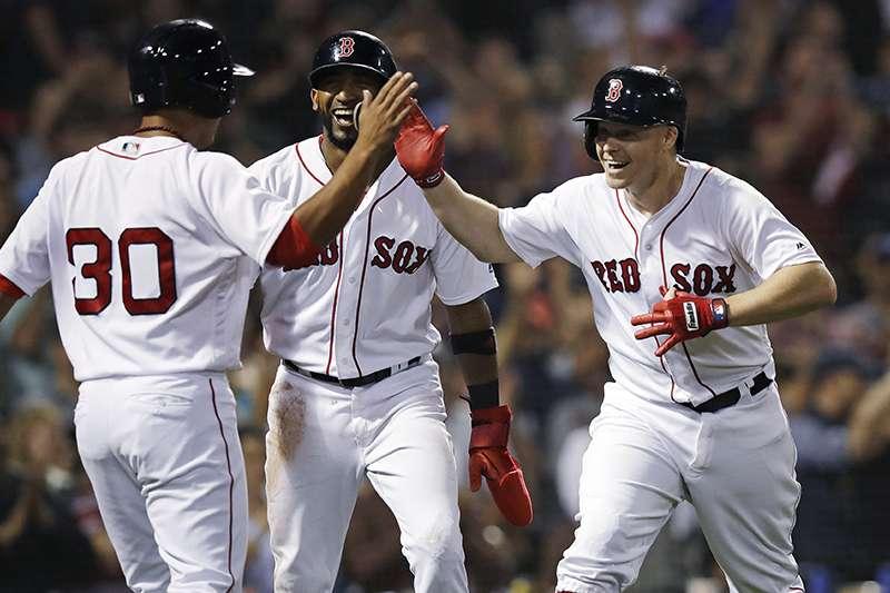 波士頓紅襪今天以7比2擊敗多倫多藍鳥,成為全聯盟第一支確定晉級季後賽的球隊。(美聯社)