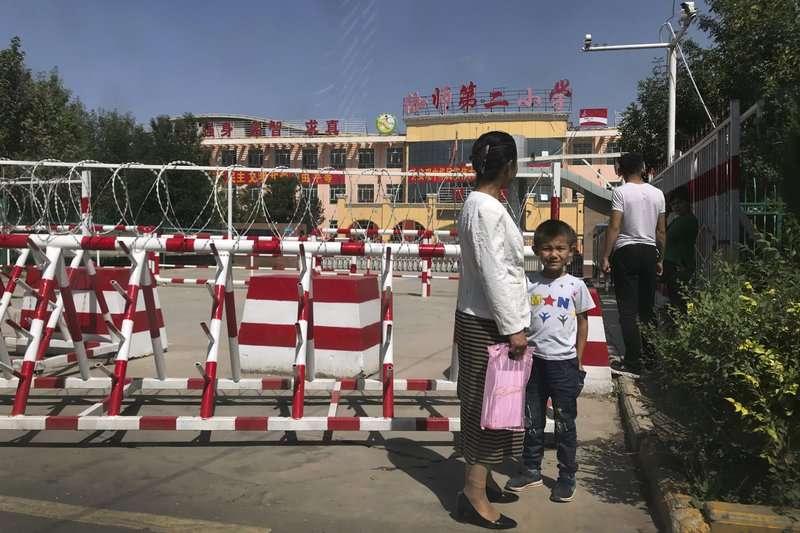 新疆地區的教育機構管理嚴格。(AP)