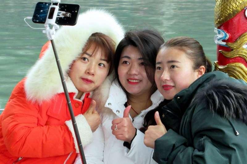 對於許多中國遊客來說,出國玩不再只是純觀光,旅遊順便一兼二顧「辦大事」是最新的潮流。(圖/David Stanley@flickr)
