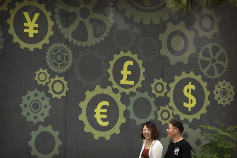 中美貿易戰陰影籠罩IMF下調明年全球經濟成長預期,台灣逆勢上升0.4%。(美聯社)