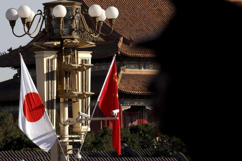 安倍近三邀請習近平明年訪日,中日雙方也重啟貨幣交換機制。(美聯社)