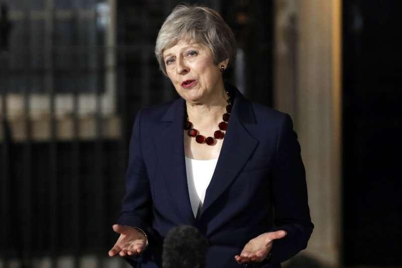 2018年11月14日英國首相梅伊宣布英國內閣通過脫歐協議草案。(AP)