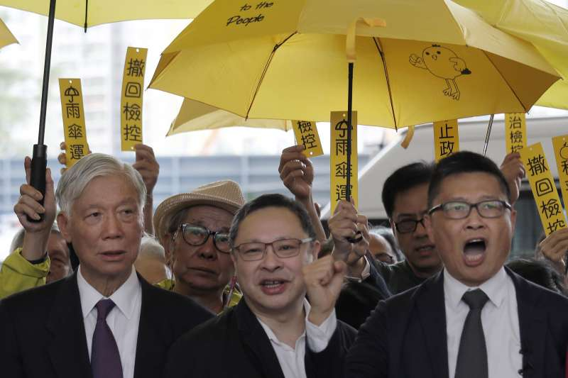 2018年11月19日,香港佔中運動9名被告被控煽惑他人作出公眾妨擾等罪,正式開審(AP)