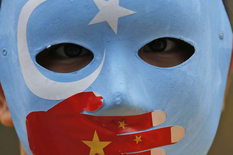 新疆哈密認定教人翻牆也是違法行為(AP)