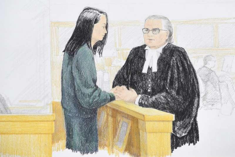 2018年12月10日,華為副董事長孟晚舟出席保釋聽證會,與律師馬丁握手。(AP)