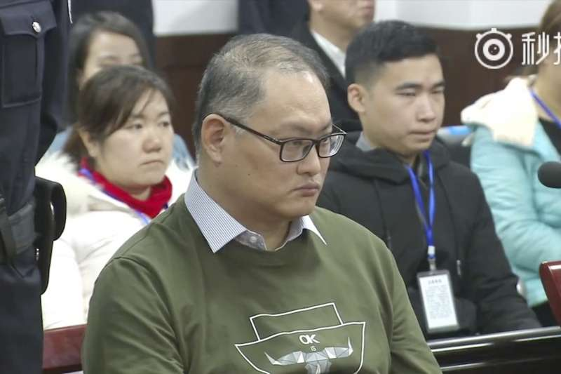 台灣人權工作者李明哲(前)於中國「被失蹤」後判刑,美國會議員打算赴中國探視。(資料照,美聯社)