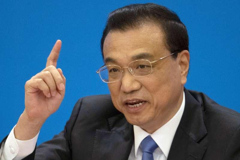 中國國務院總理李克強在本次人大閉幕後記者會指出,會推出一系列有關法規和文件,讓《外商投資法》順利實施。 (AP)