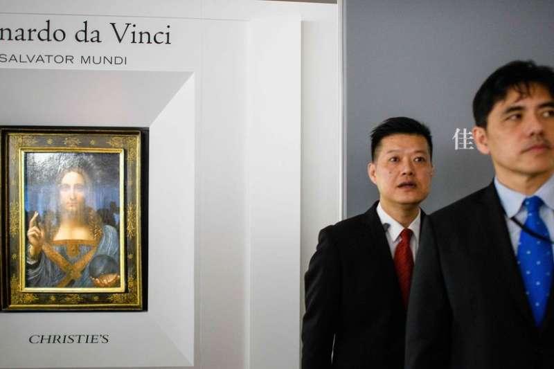 李振成(右)曾在香港知名拍賣公司工作。(BBC中文網)