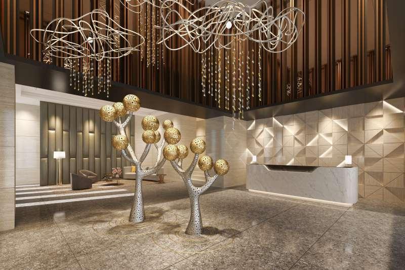 大廳放置由黃沛瀅、施承澤等藝術家創作的大型金屬藝術品「沐恩」。(圖/鴻承建設  )